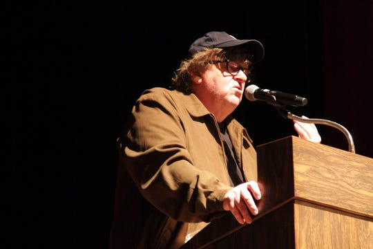 Flint documentary filmmaker Michael Moore addresses the audience during a screening of his new film Farenheit 11/9 at The Whiting auditorium in Flint, Michigan on Monday, September 10, 2018.