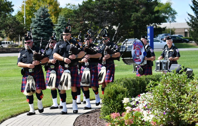 The Metro Detroit Police and Fire Pipes and Drums play at the Michigan Fallen Heroes Memorial in Pontiac on Sept. 11, 2018.