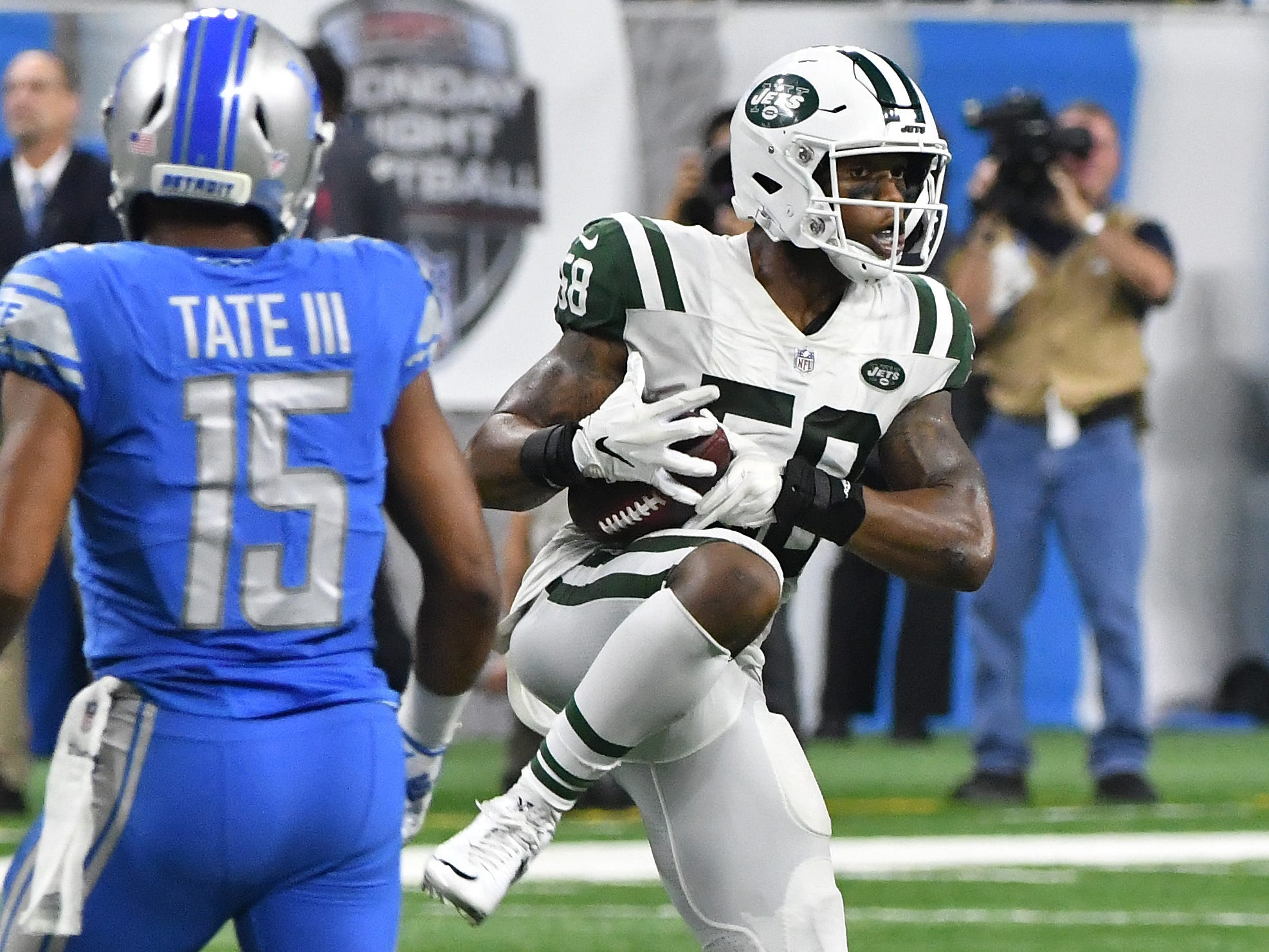 Jets' Darron Lee intercepts a pass by Lions quarterback Matthew Stafford in the third quarter.