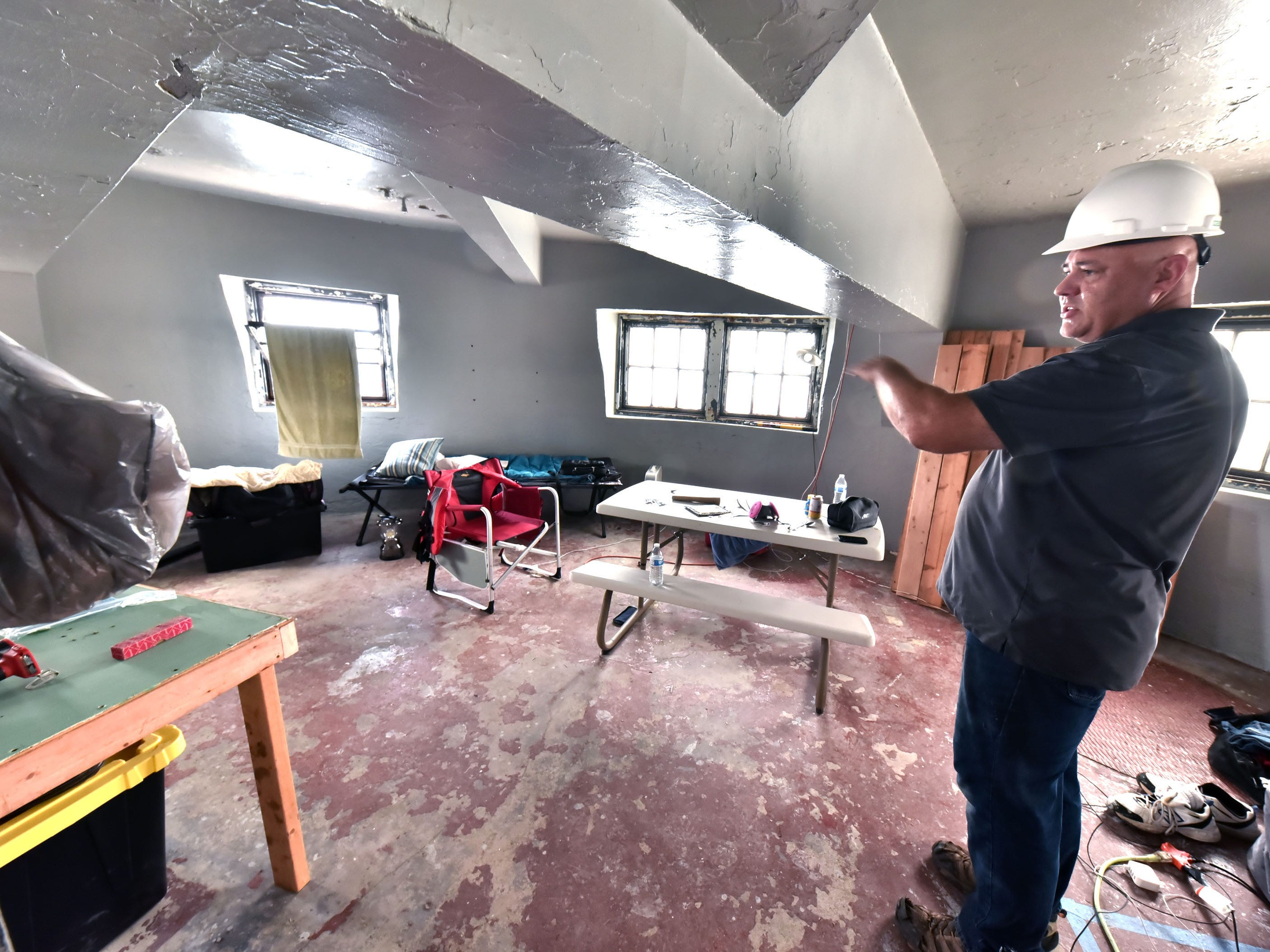 Brent Tompkins, co-owner of the White Shoal Lighthouse, stands in a bedroom  in the 108-year-old structure in Lake Michigan. Tompkins and Marty Rosalink purchased the lighthouse in an auction in 2016. Sunday, Sept. 2, 2018