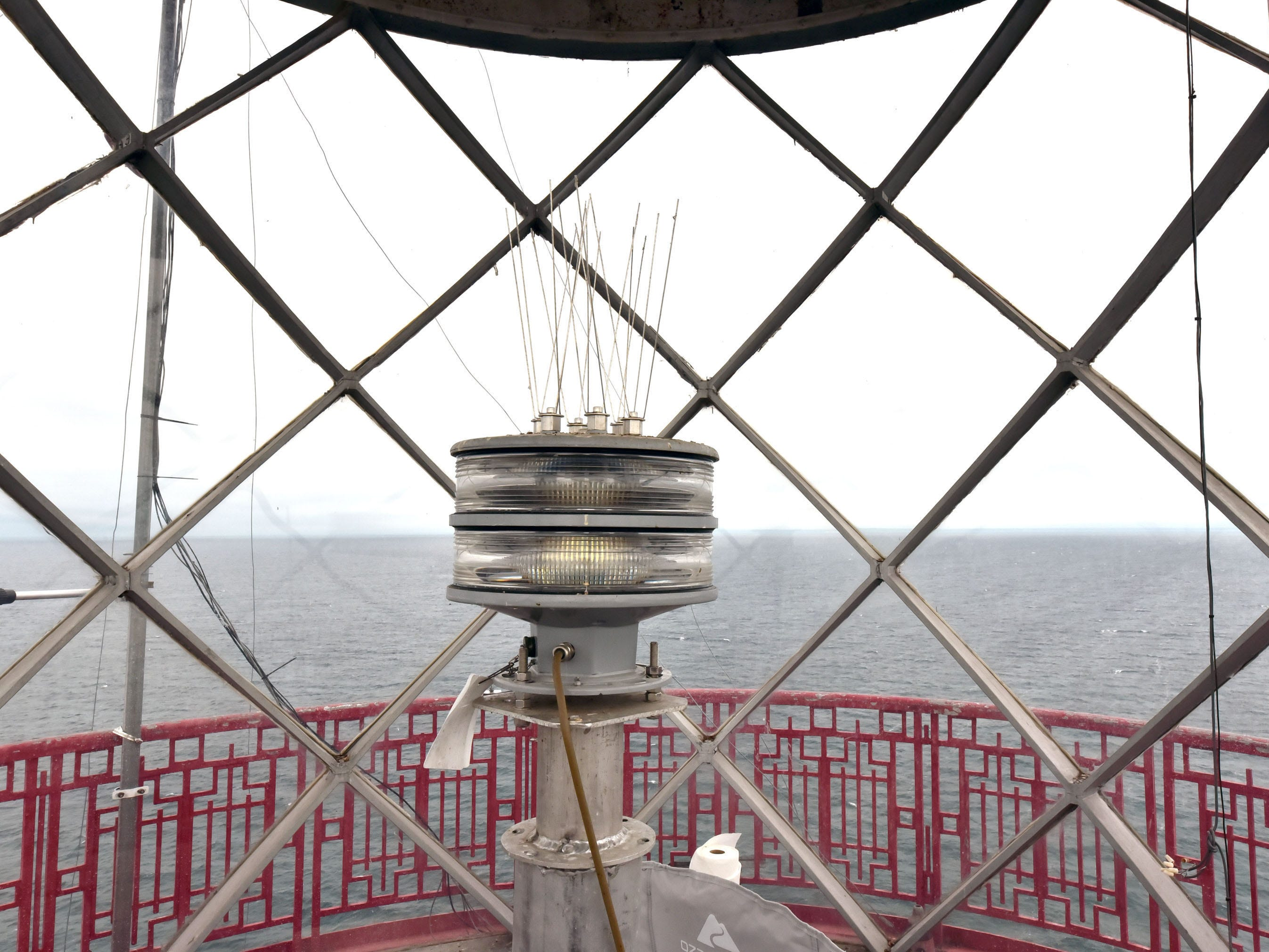 The rotating light in the tower at the White Shoal Lighthouse can throw a beam 28 miles, and is maintained once a year by the U.S. Coast Guard. Sunday, Sept. 2, 2018.