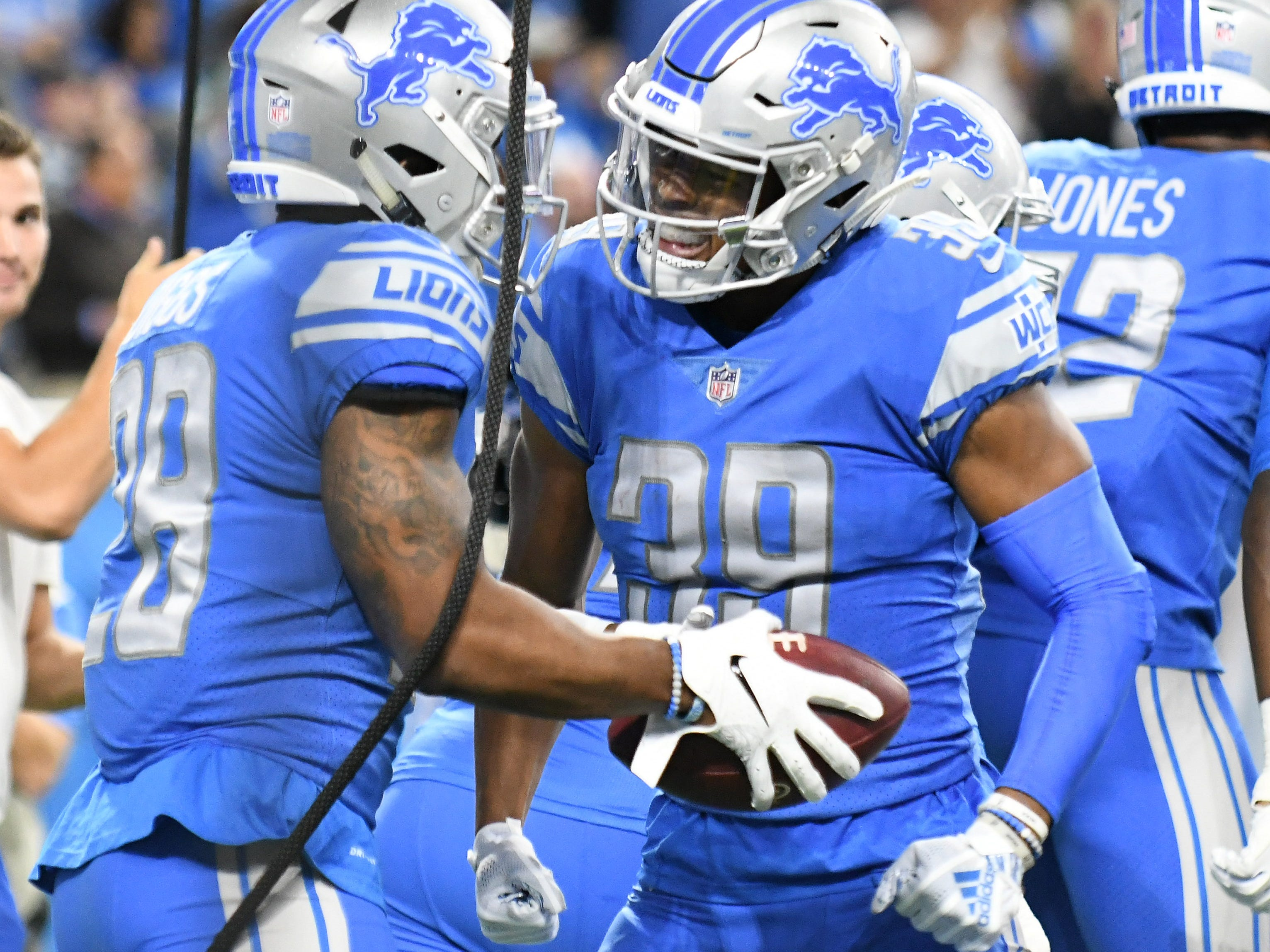 Lions defensive back Quandre Diggs, left, celebrates his touchdown with corner back Jamal Agnew, right, in the first quarter.