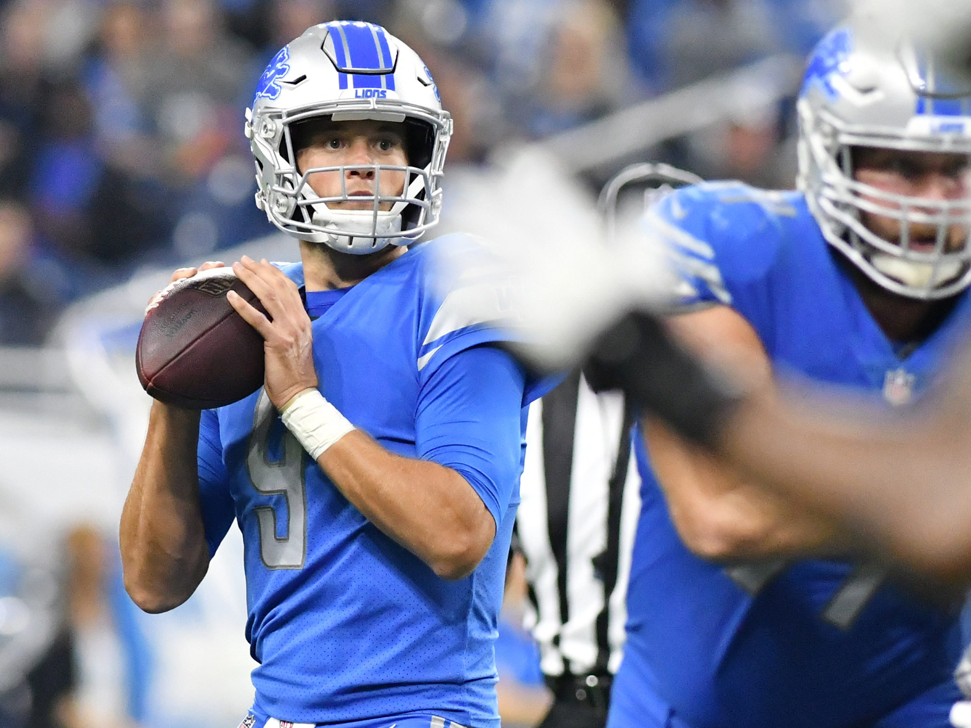 Lions quarterback Matthew Stafford looks for a man in the end zone in the first half.