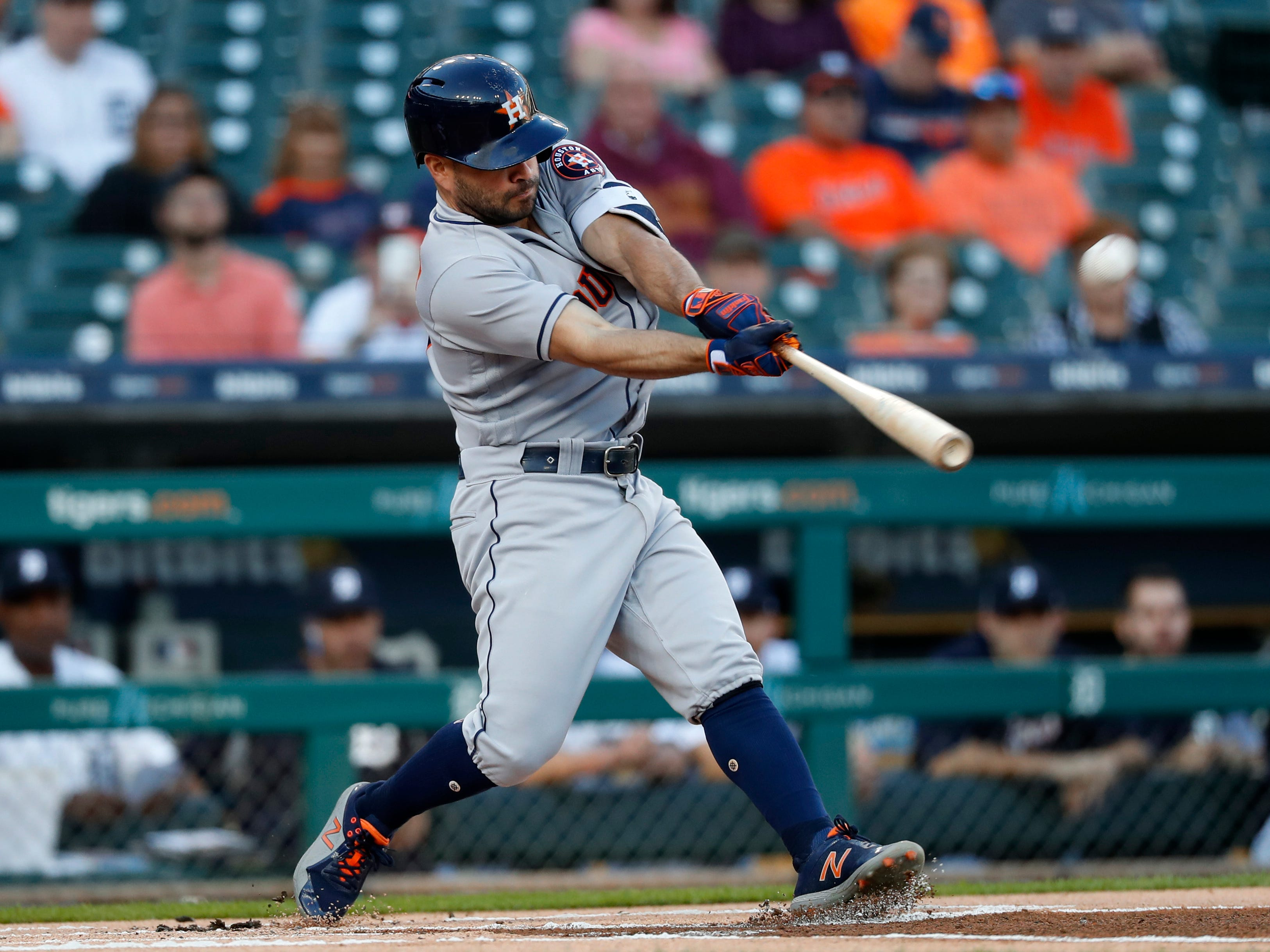 Houston Astros' Jose Altuve hits a leadoff solo home run against the Detroit Tigers in the first inning.