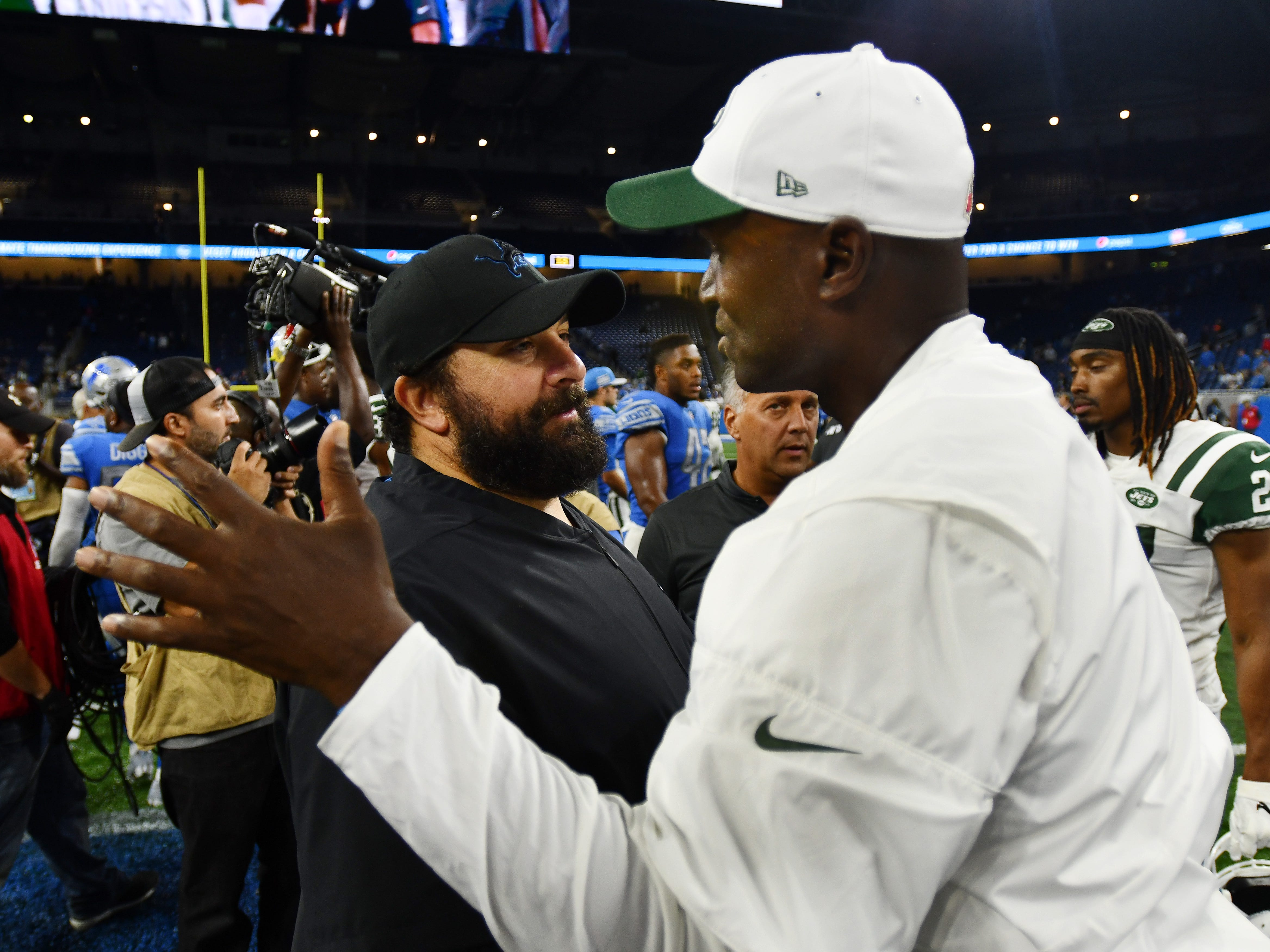 Lions head coach Matt Patricia and Jets head coach Todd Bowles meet on the field after Detroit loss to New York in the fourth quarter.