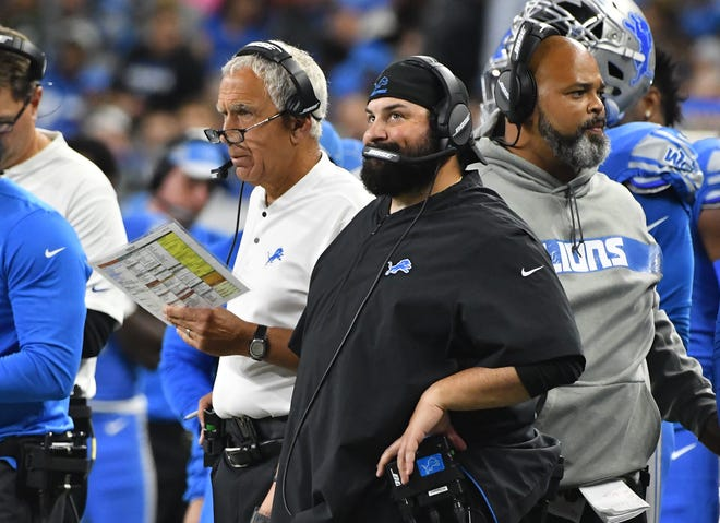 Lions defensive coordinator Paul Pasqualoni, left, and head coach Matt Patricia look on during the first quarter Monday night.