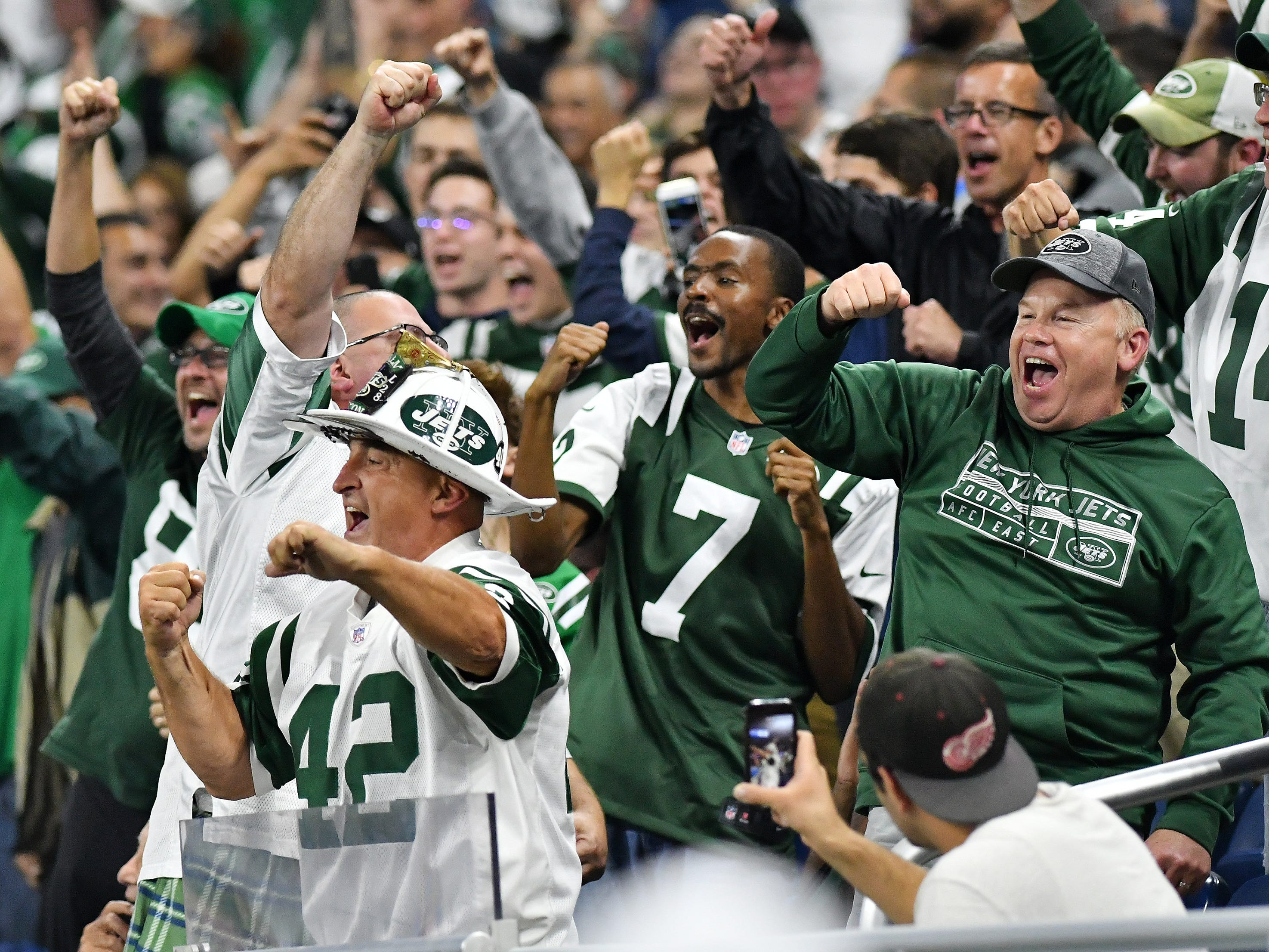 Jets fans celebrate the score of 48-17 late in the fourth quarter.
