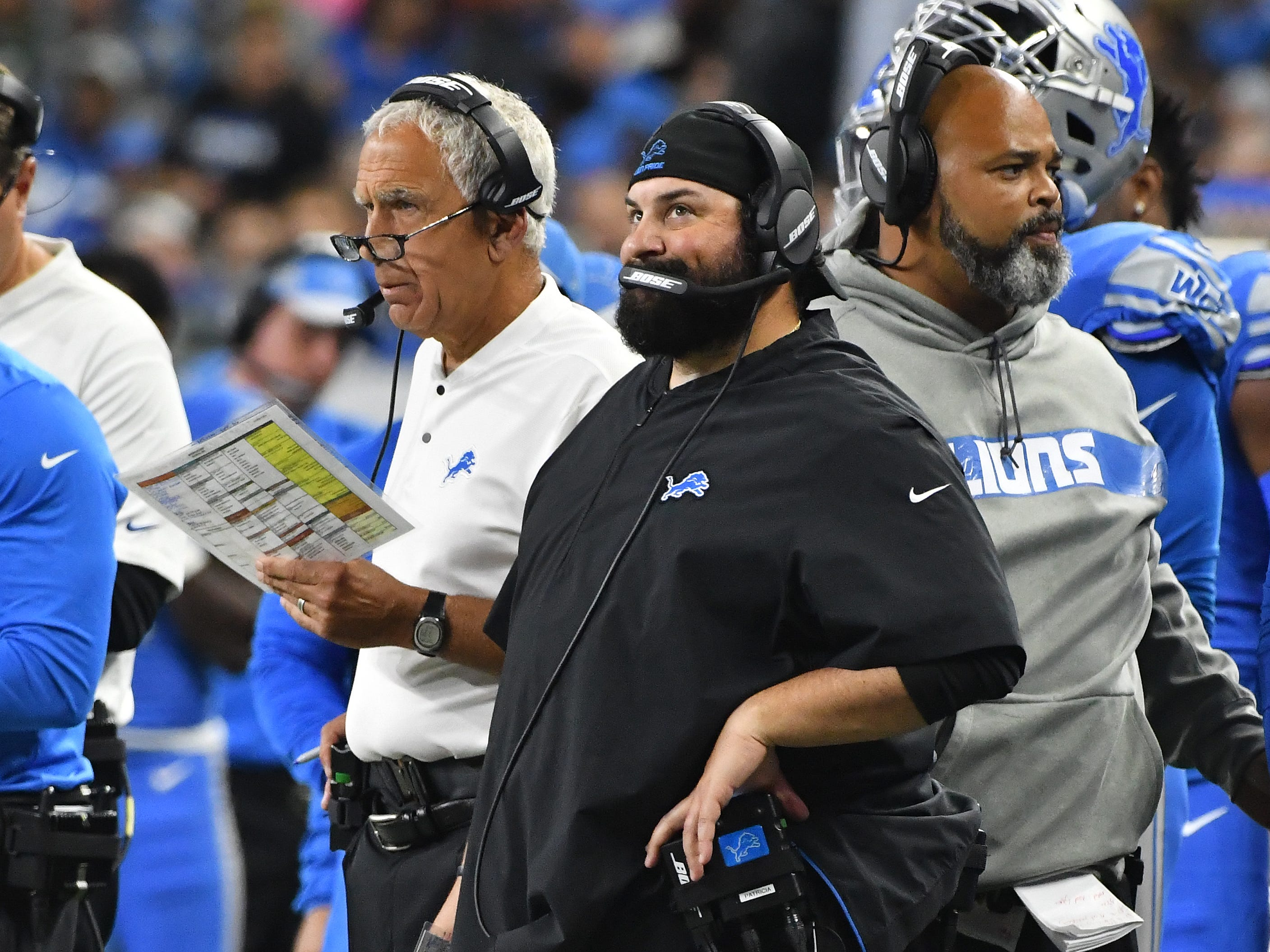 Lions defensive coordinator Paul Pasqualoni and Lions head coach Matt Patricia watch the game from the sidelines in the first quarter.