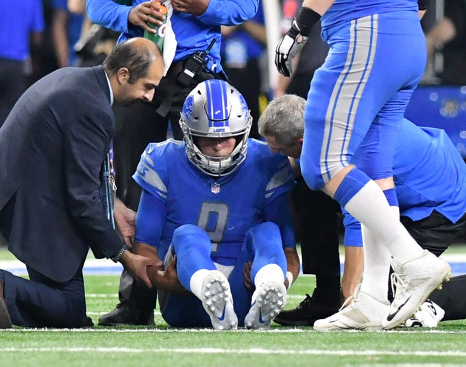 Lions QB Matthew Stafford gets checked out by the team's medical staff after taking a hard hit in the third quarter. Stafford returned to the game, but had a rough season opener, throwing four interceptions at Ford Field in Detroit as the Lions lost to the New York Jets 48-17 on Monday Night Football, September 10, 2018.
