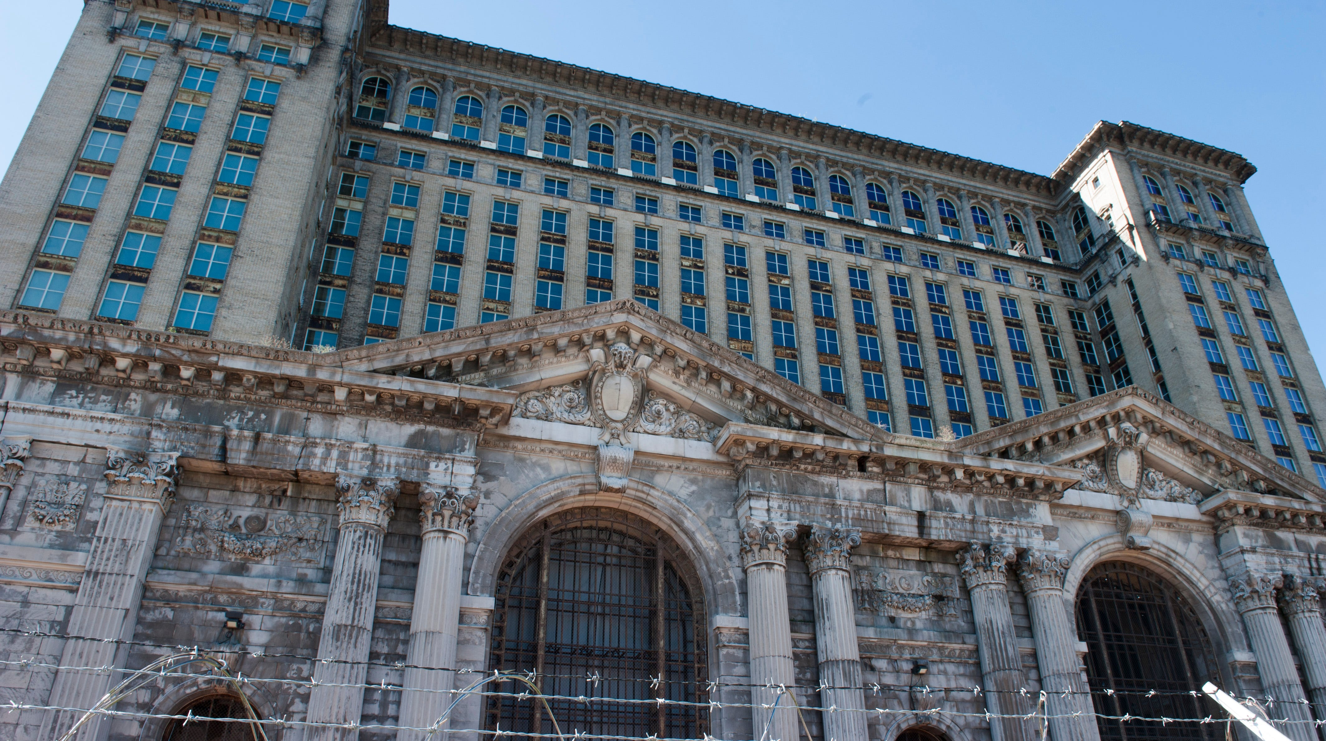 Exterior of the Michigan Central Station in Detroit. While Ford Motor Company prepares to move some of its operations to the Michigan Central Station in Detroit's Corktown neighborhood, the Ford Fund commisioned Rebel Nell, a social entrepreneur, to repurpose layers of graffiti paint from the wallls inside the massive structure and turn them into one-of-a-kind pieces of jewelry. Photos taken on Tuesday, September 11, 2018.