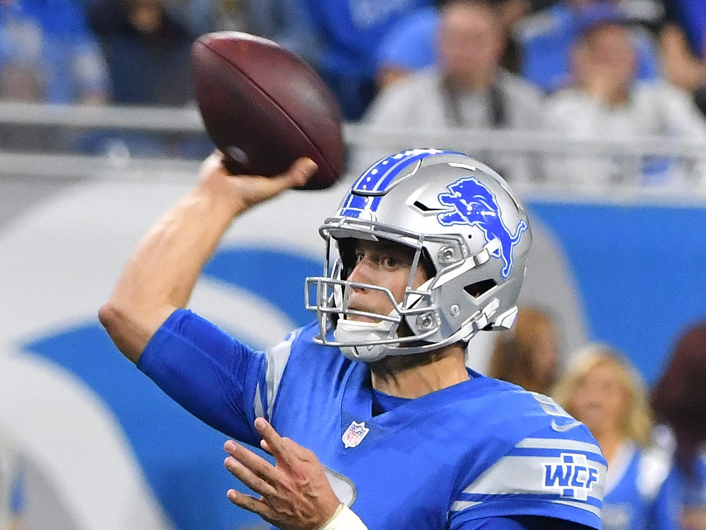 Lions quarterback Matthew Stafford throws in the fourth quarter.