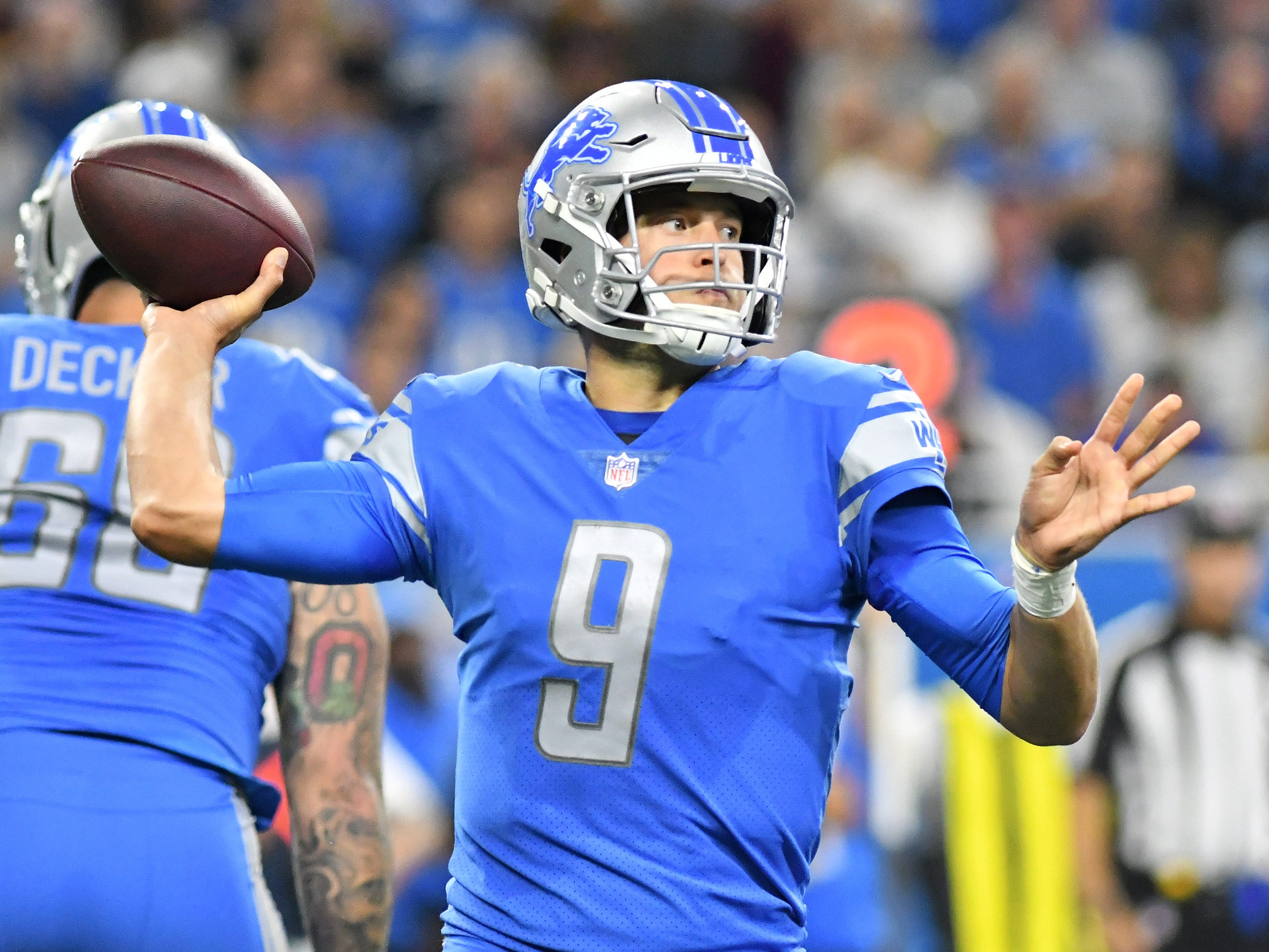 Lions quarterback Matthew Stafford passes the ball in the second quarter.