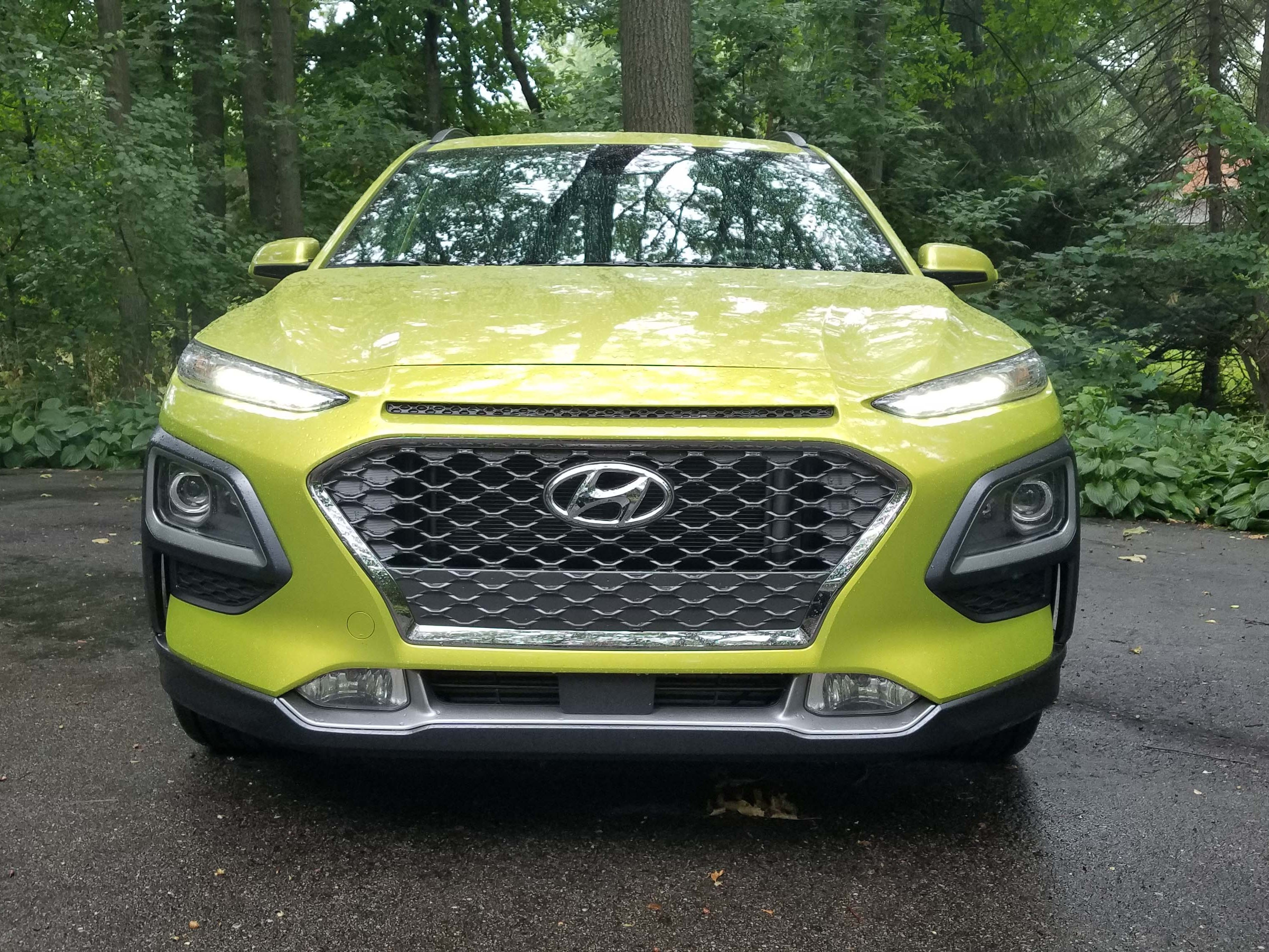 The 2018 Hyundai Kona features a funky front end reminiscent of Jeep's last-gen, 2016 Cherokee - three shelves of lights border the big grille with the running lights on top (!) and the headlights in the middle.