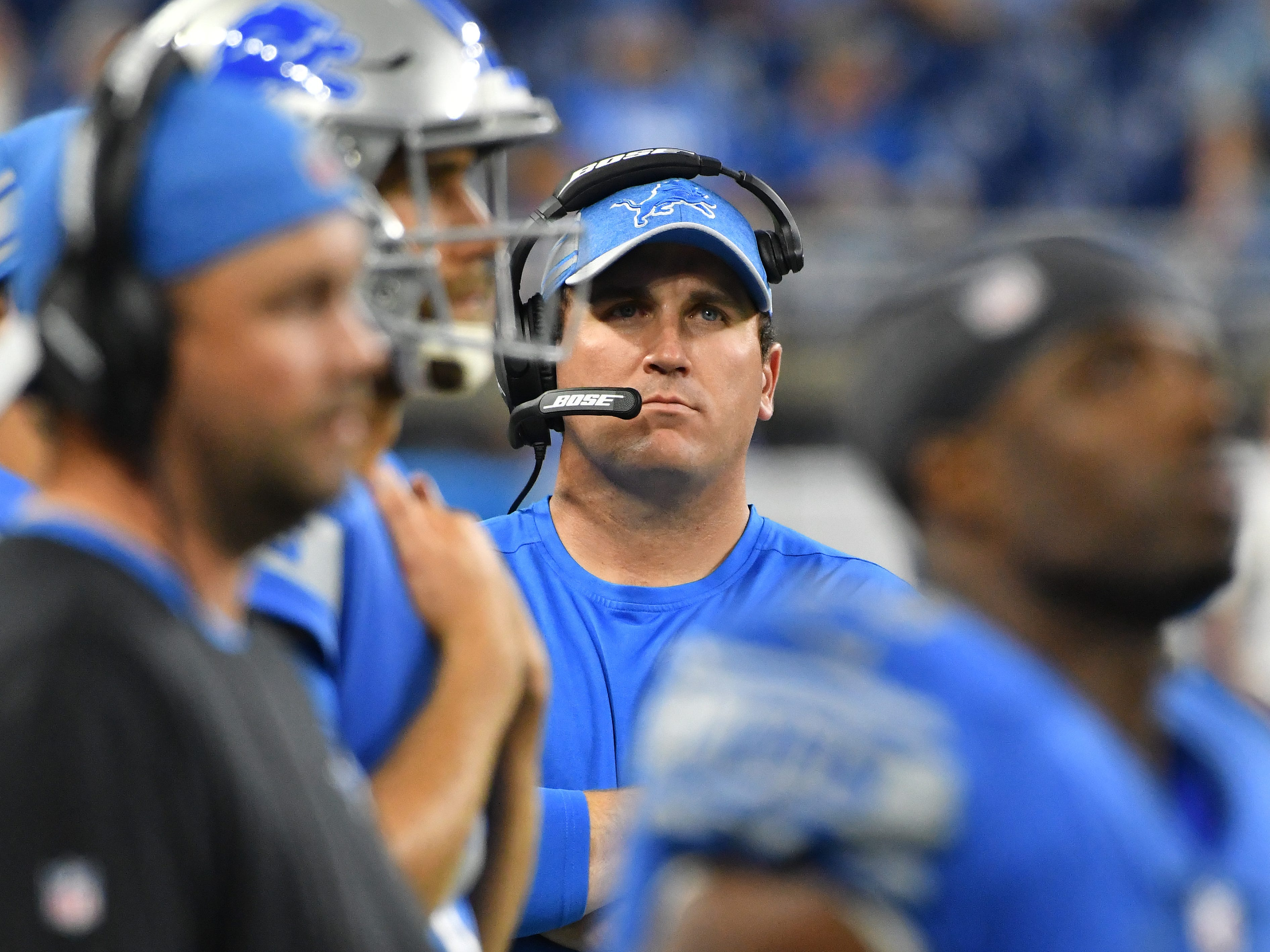 Lions offensive coordinator looks to the video screen as the final seconds of the game tick off with Detroit losing to the New York Jets 48-17.