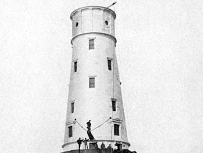 The brick tower of the White Shoal Light is under construction in 1909.