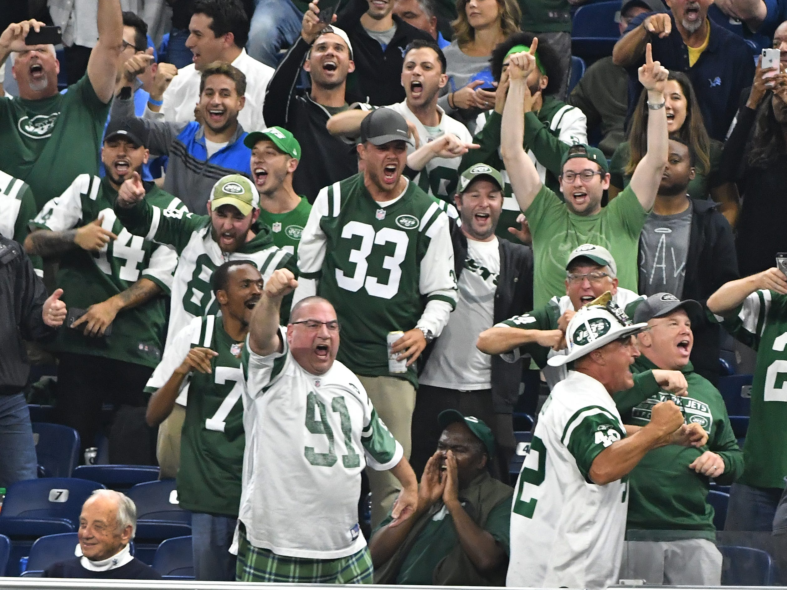 "New York Jets fans take over the stands behind the New York bench, due to Detroit fans leaving early, and chant ""Jets, Jets, Jets"" late in the fourth quarter."