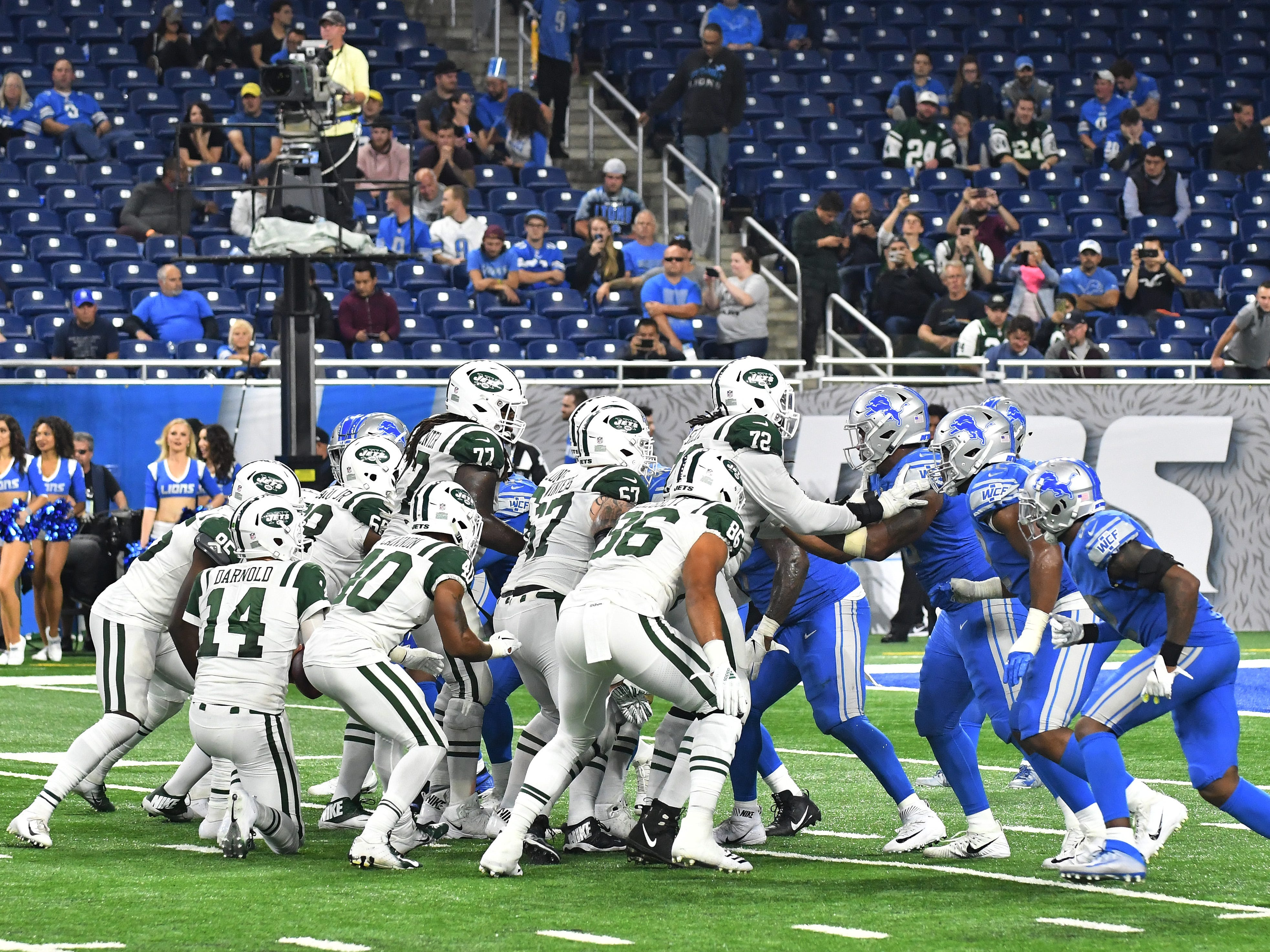 The Jets take a knee, one of four, before turning it over to the Lions, who then took a knee to run out the clock, losing 48-17 in the home opener.