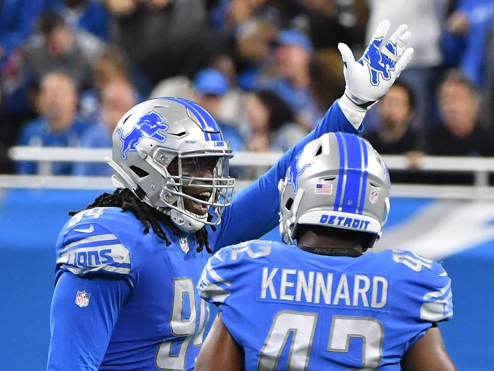 Lions Ezekiel Ansah celebrates his sack of Jets quarterback Sam Darnold in the first quarter.