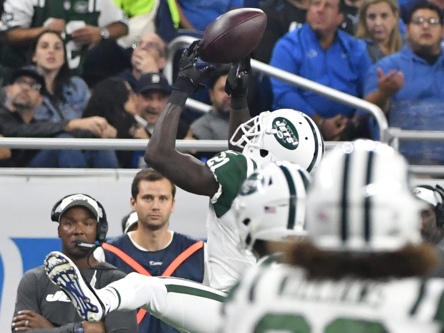 Jets' Morris Claiborne intercepts a pass intended for Lions' Marvin Jones Jr. in the first quarter.