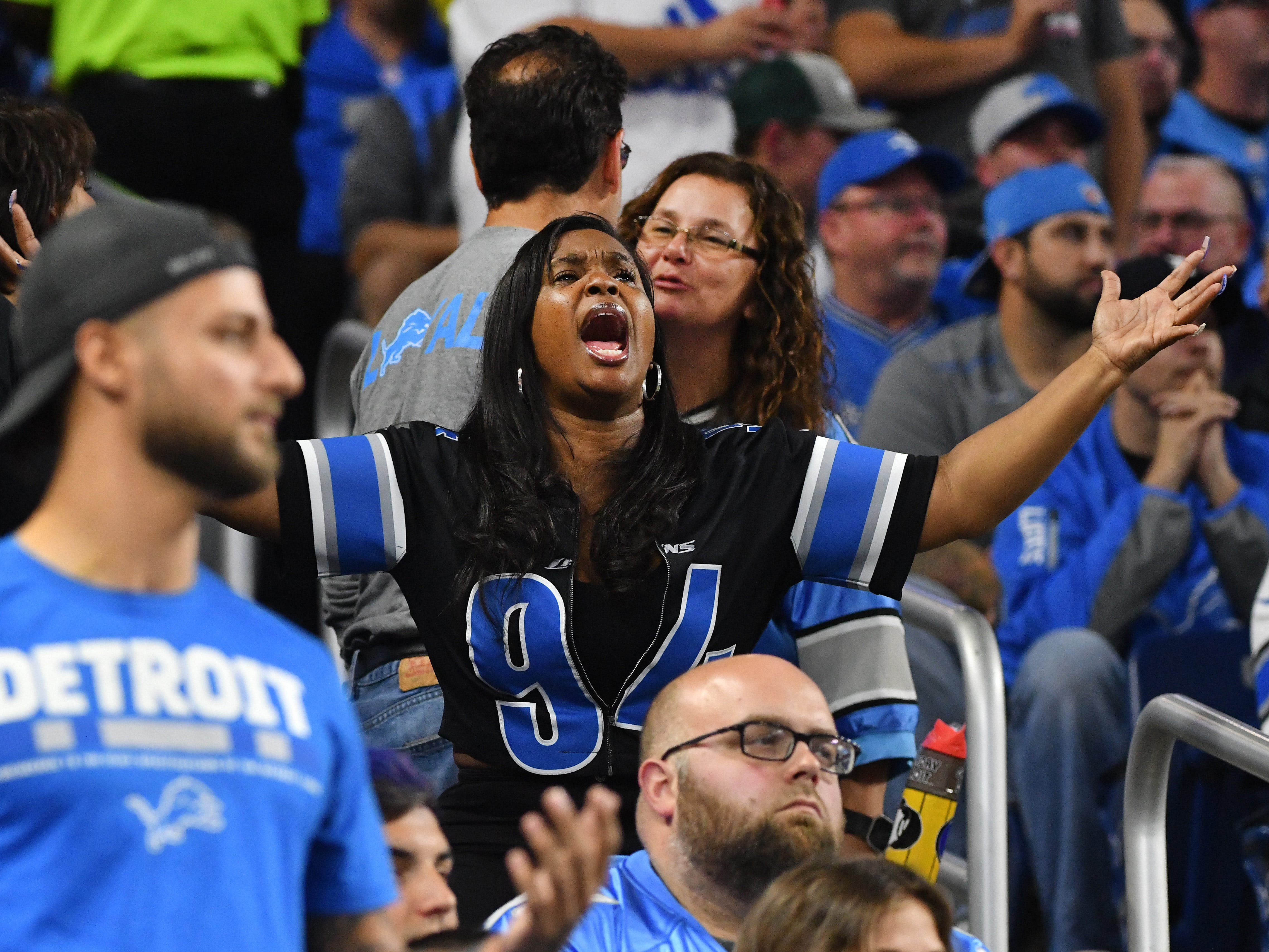 A Lions fan throws her hands as the Lions punt after another offensive drive stalls on the field in the second quarter.