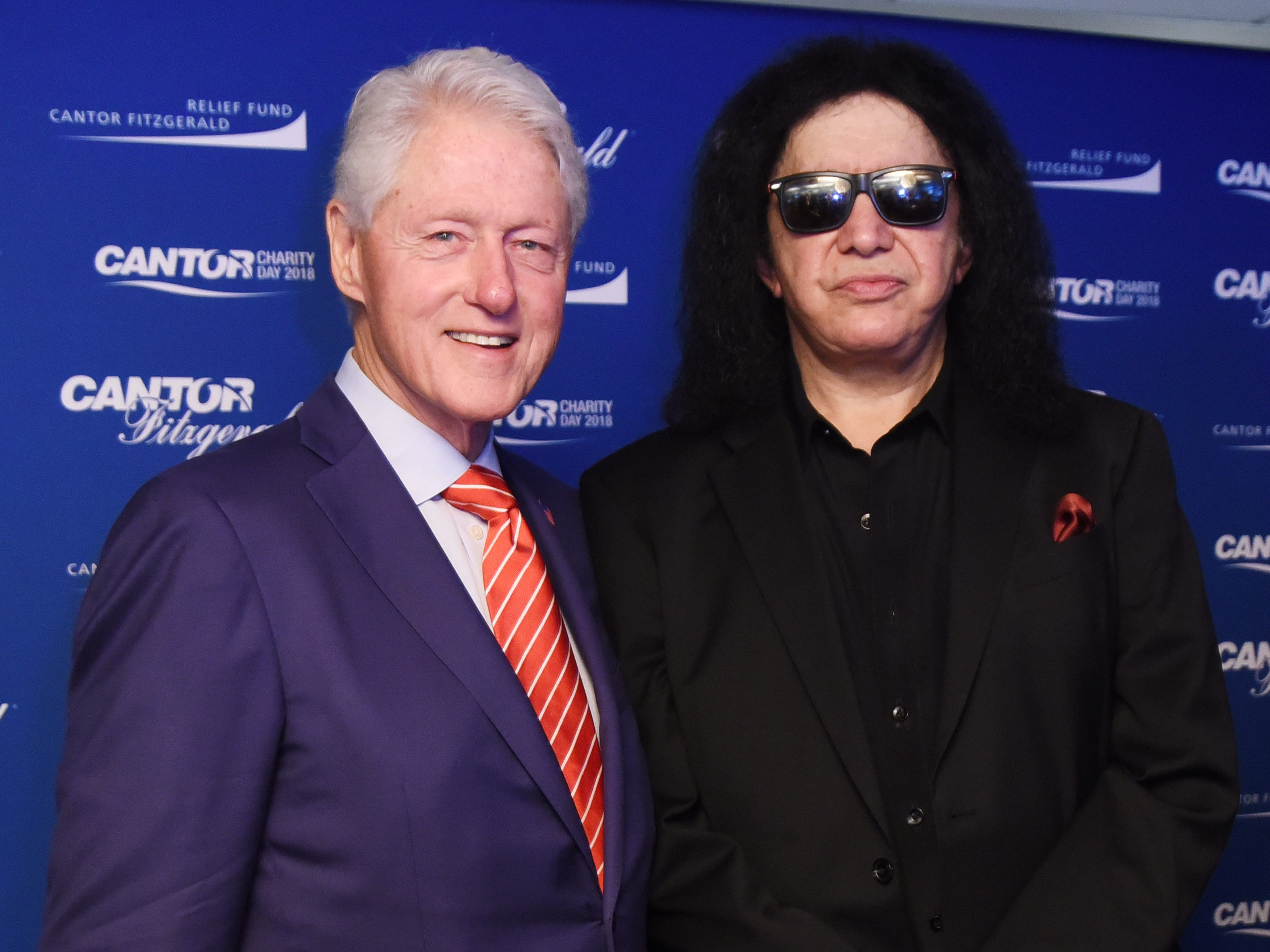 NEW YORK, NY - SEPTEMBER 11: Bill Clinton and Gene Simmons attend the Annual Charity Day hosted by Cantor Fitzgerald, BGC and GFI at Cantor Fitzgerald on September 11, 2018 in New York City.