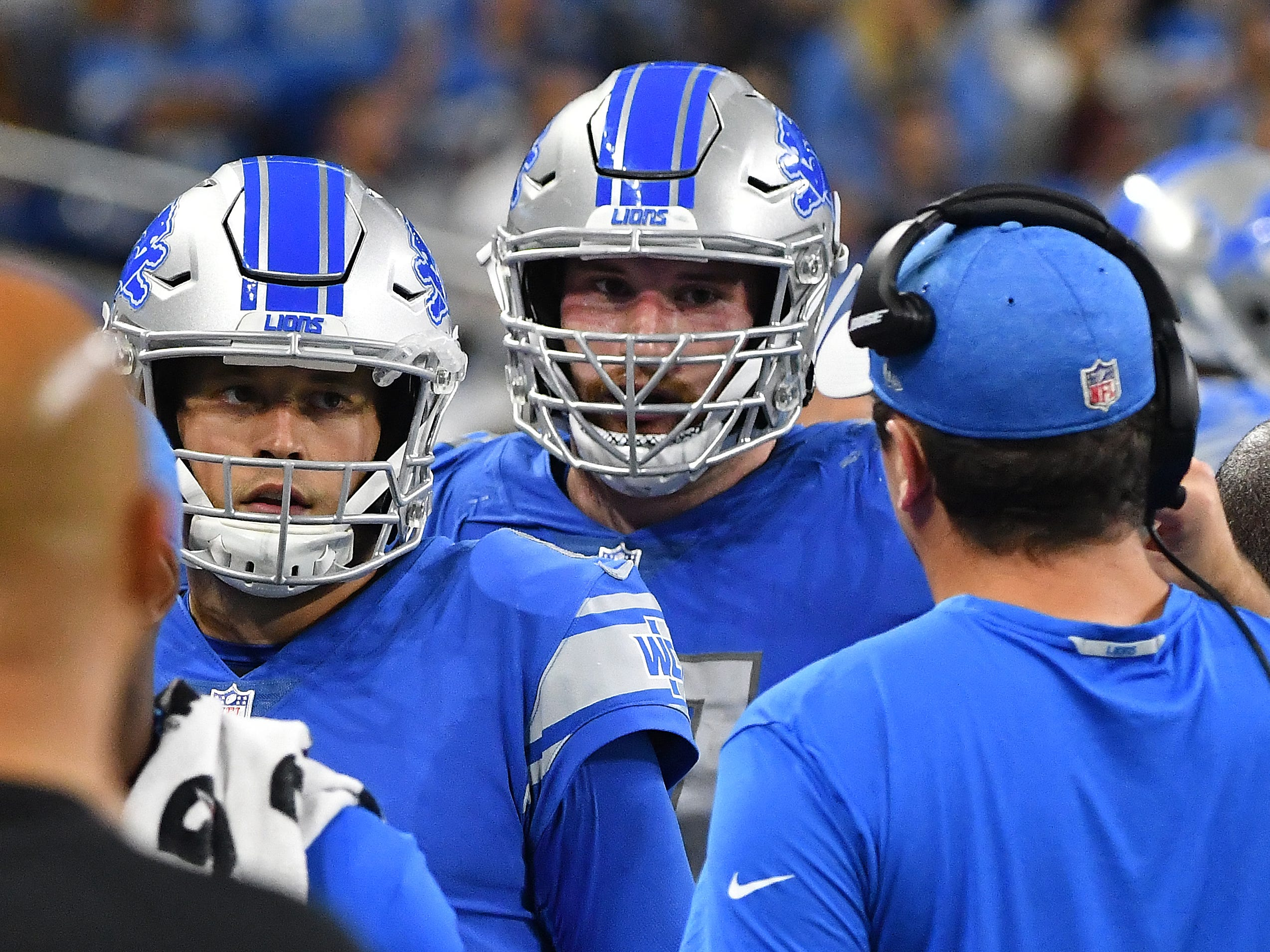 Lions quarterback Matthew Stafford and offensive lineman Frank Ragnow head back to the sidelines and offensive coordinator Jim Bob Cooter after an interception by Jets' Darron Lee in the third quarter.