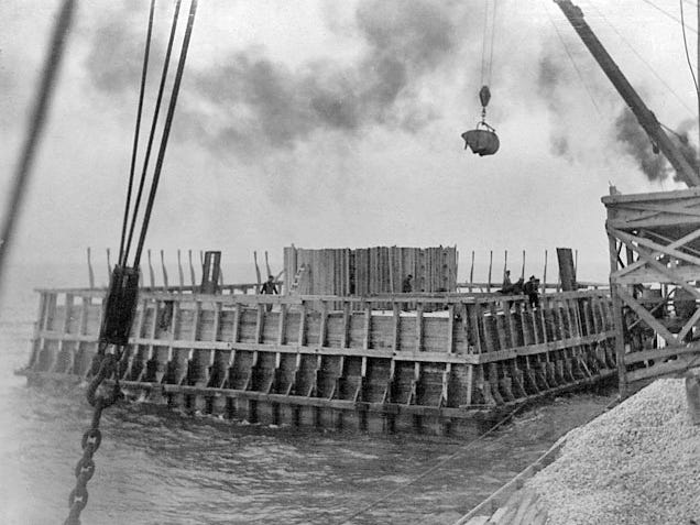 Rock is placed in the crib of the White Shoal Light in 1910. Rock weighing 4,000 tons was covered by 3,700 tons of concrete in building the base.