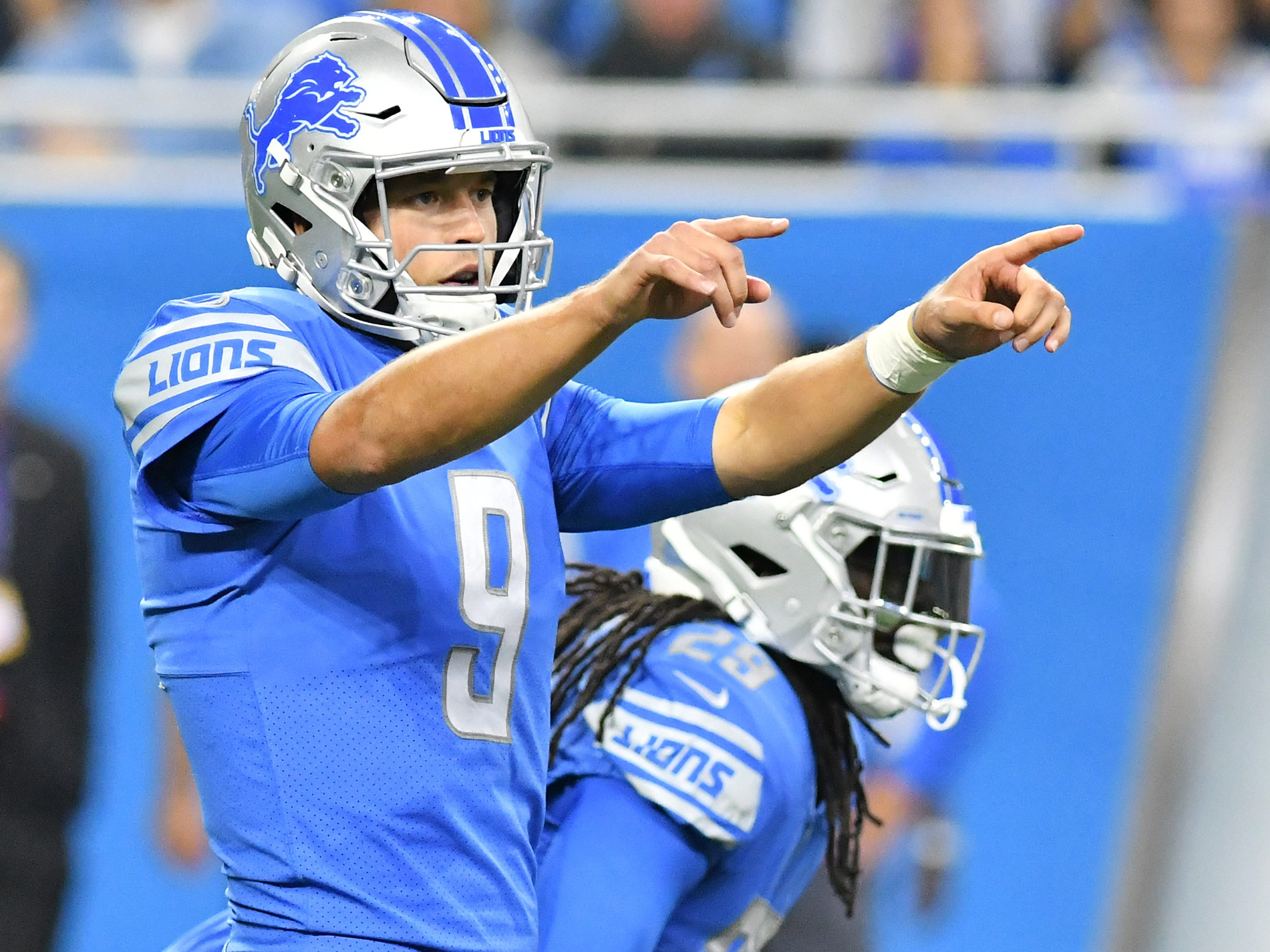Lions quarterback Matthew Stafford before the snap in the first half.
