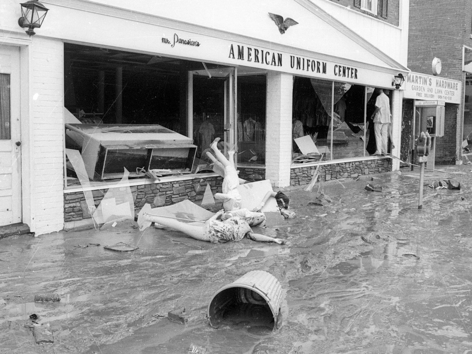 The American Uniform Center on South Main Street in Elmira was in the path of Agnes. This photo was taken during the week after the flood.