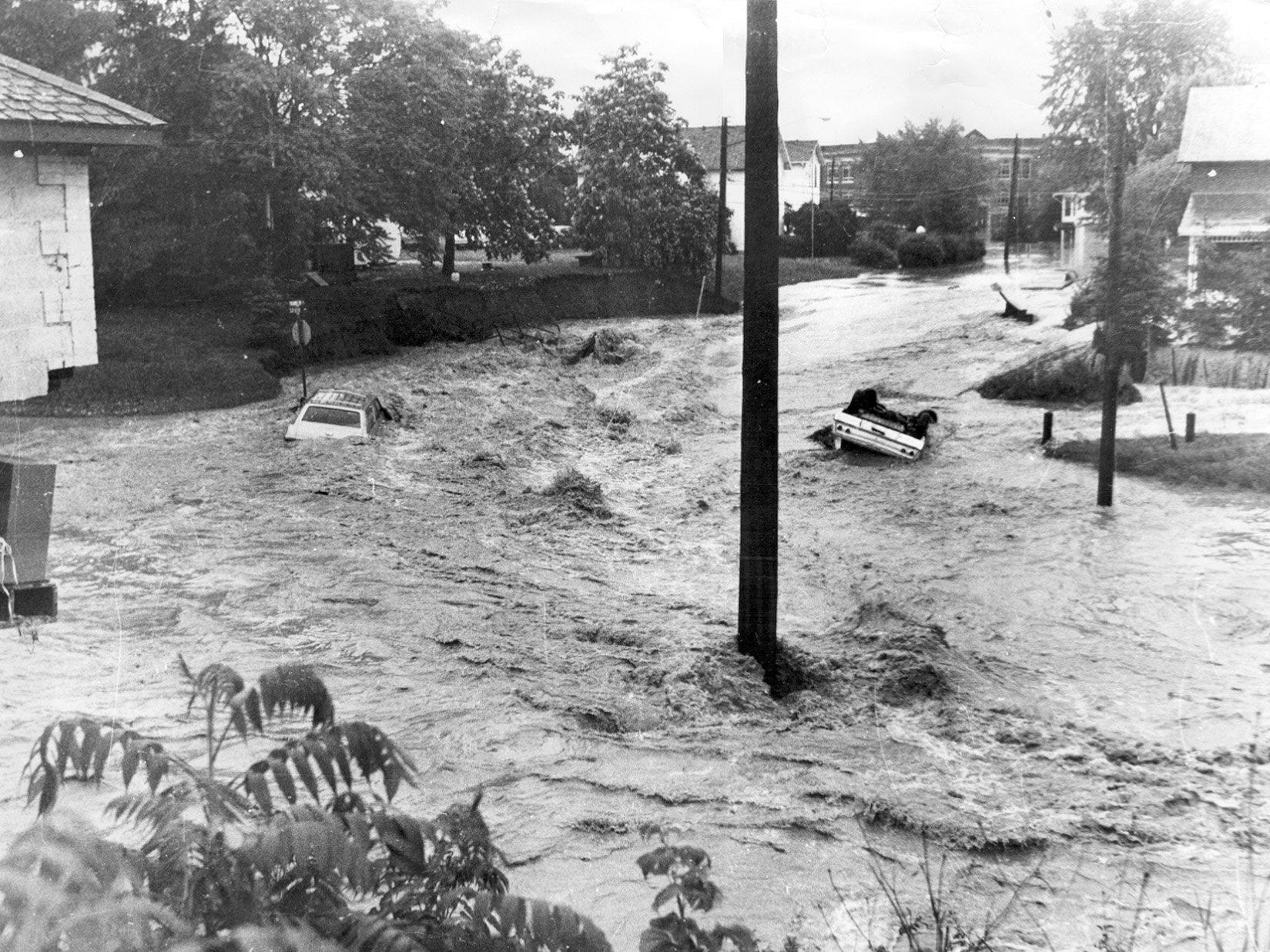 Raging waters flow through Elmira's Franklin Street and South Avenue during the flood of 1972.