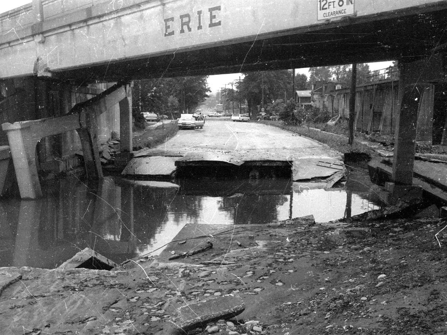 Agnes washed away part of Pennsylvania Avenue at the old Erie Railroad bridge looking toward the old Southside High School.
