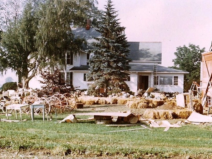 Much of the contents of the house and barns at Wyldwyn Farm on Carpenter Road in Big Flats were hauled out onto the lawn and driveway. The ladder against the house roof was how Carol Christian got into the house on the Saturday morning after the water receded. The doors were all swollen shut and couldn't be opened. She got in through a bedroom window her parents had left open when they departed by boat the morning before.