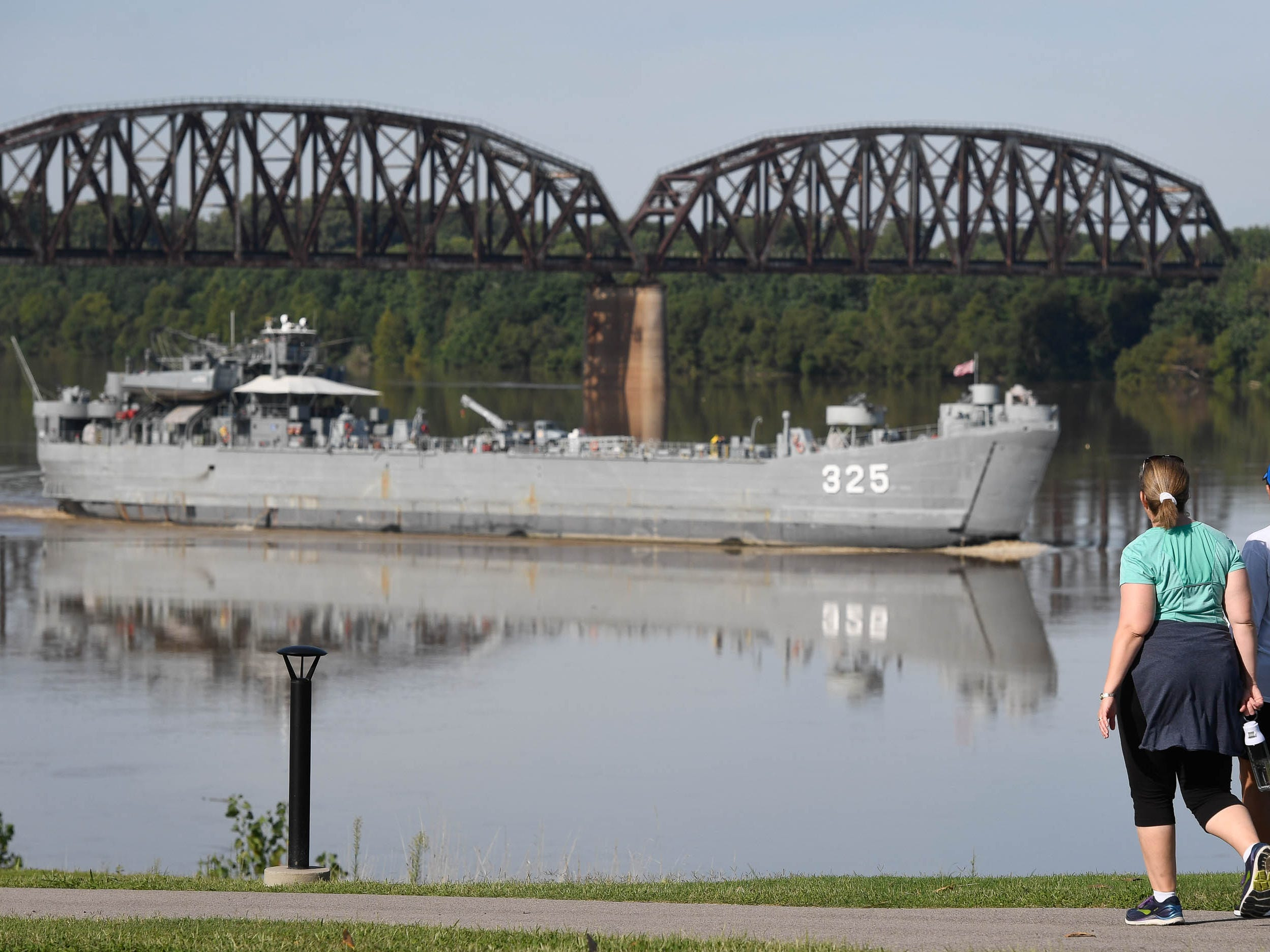 Out for a morning walk, Tanna Williams, left, and Julie Beickman got a visual treat as the LST 325 sails up-stream past the Henderson riverfront on it's way back to Evansville Tuesday, September 11, 2018.