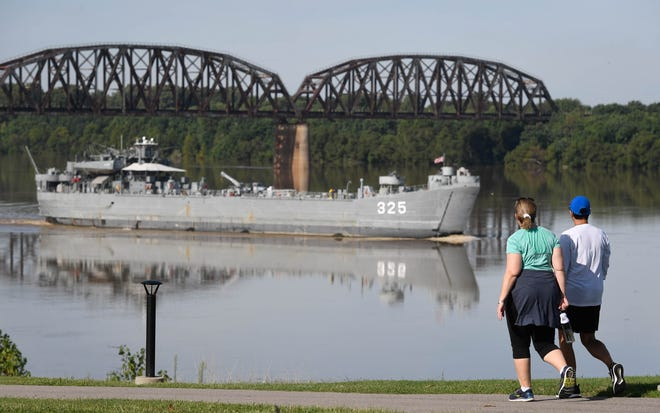 Out for a morning walk, Tanna Williams, left, and Julie Beickman got a visual treat as the LST 325 sails up-stream past the Henderson riverfront on its way back to Evansville on Sept. 11, 2018.