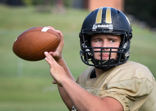 Boonville High quarterback Jackson Phillips (10) looks for a receiver during afternoon practice in Boonville Monday, September 10, 2018.