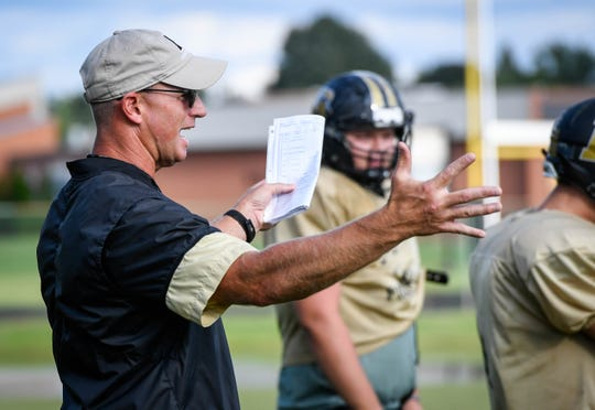 Darin Ward (left) has been the Boonville football head coach since 2015. He is 29-15 in four seasons at his alma mater.