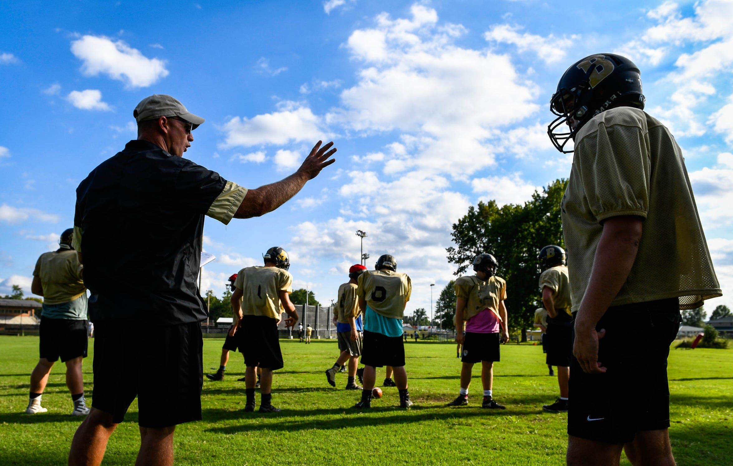 Preparing for their next game, Boonville High head coach Darin Ward talks to his team during afternoon practice in Boonville Monday, September 10, 2018.