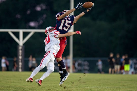 Heritage Hills' Cole Sigler intercepted a pass intended for Tell City's Kyle Simpson, which was later ruled invalid due to pass interference, during the first quarter of Friday's game against Tell City in Lincoln City. Heritage Hills defeated Tell City, 49-0. Nic Antaya/The Herald