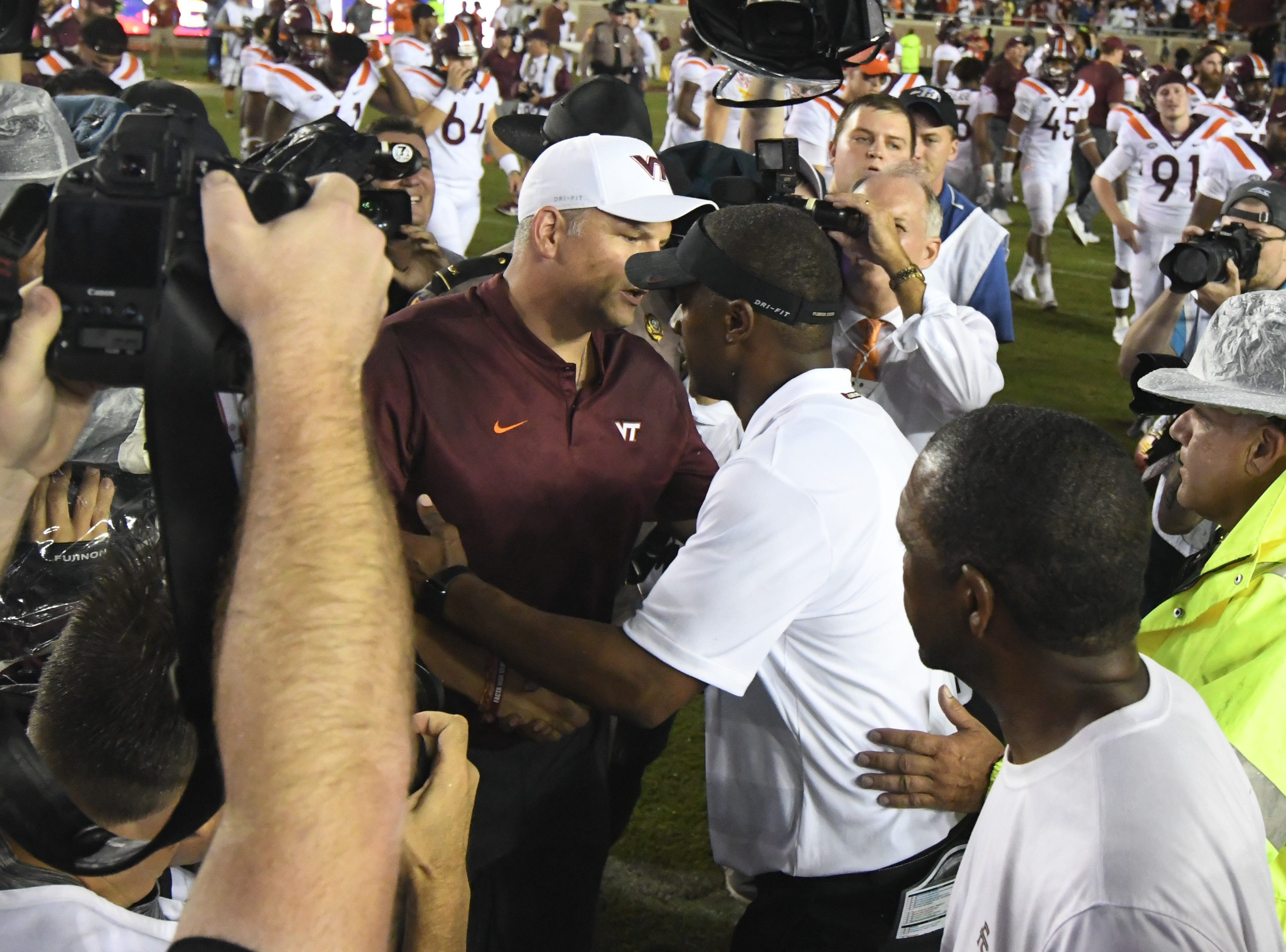 FSU head coach Willie Taggart shaking hands with Virginia head coach Justin Fuente after the game on Monday night at Doak Campbell Stadium.