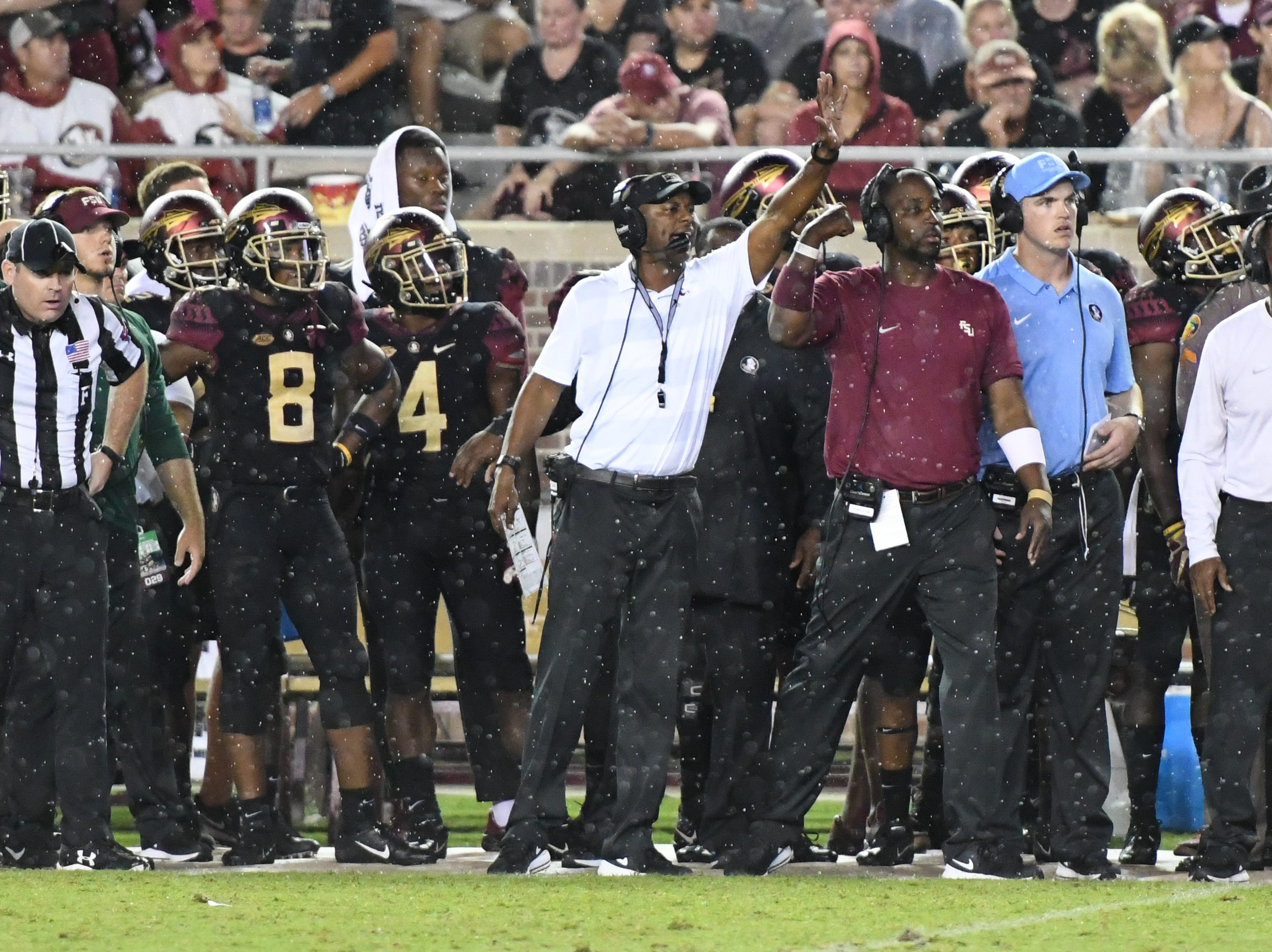 FSU head Coach Willie Taggart calling a play from the FSU sideline during the third quarter of FSU's matchup against Virginia Tech on Monday night.