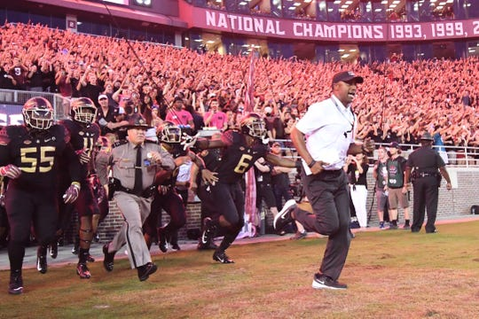 FSU Head Coach Willie Taggart leading the Seminoles out opf the tunnel on Moday night at Doak Campbell Stadium.