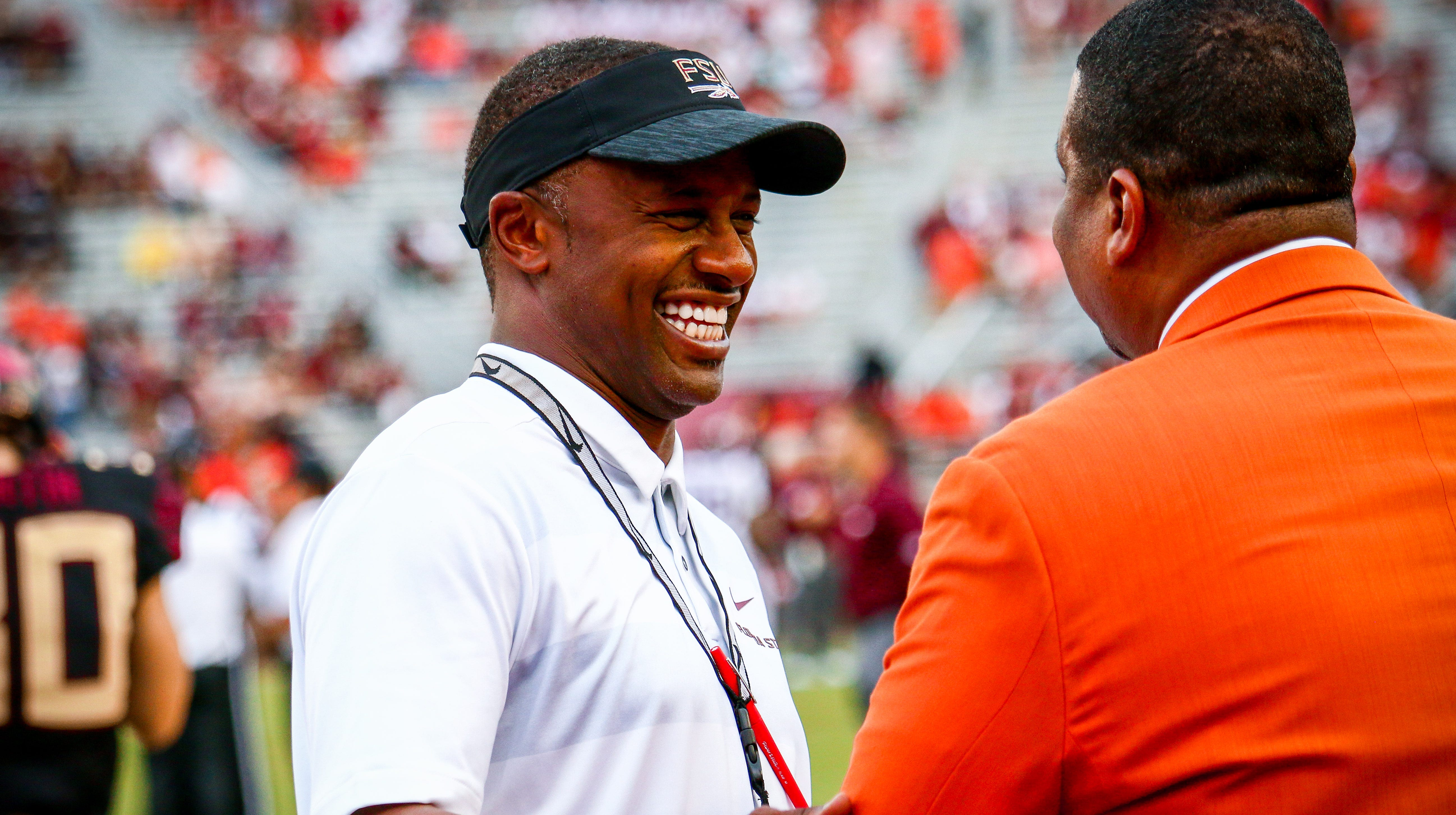 FSU Head Coach, Willie Taggart, shook hands with fans and talked with former FSU coaches and players prior to kickoff at Doak Campbell Stadium. Taggart was all smiles before the game against #20 Virginia Tech on Monday, September 3rd.