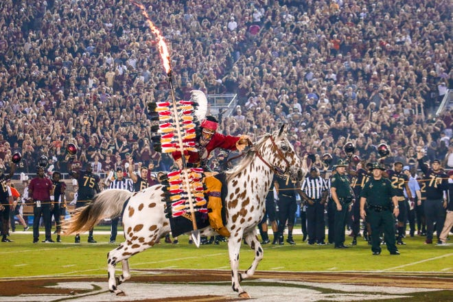 Osceola and Renegade always make Doak Campbell stadium erupt with the planting of the Spear.