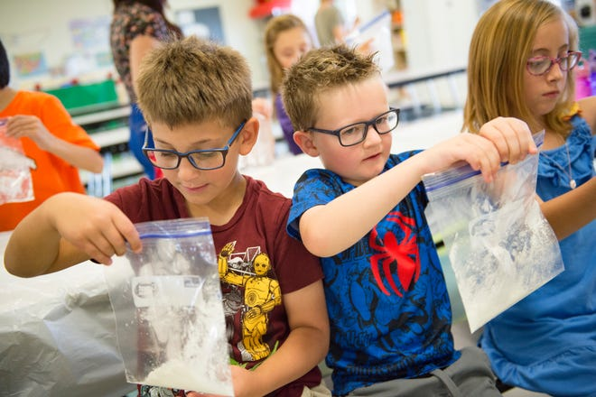 Calvin Pearson and Grayson Ballou mold a plastic substitute that they made during Cub Care at Brantner Elementary School in Thornton on Monday, September 10, 2018. Brighton's School District 27J offers childcare on Mondays since moving to four-day school weeks.