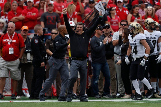 Sep 8, 2018; Lincoln, NE, USA; Colorado Buffaloes head coach Mike Macintyre reacts after scoring against the Nebraska Cornhuskers in the first half at Memorial Stadium. Mandatory Credit: Bruce Thorson-USA TODAY Sports