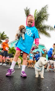 Natalie Recker, of Cape Coral, gets ready for the mile walk with her dogs, Lulu and Willie. The event was a fundraiser for the Cape Coral Animal Shelter.