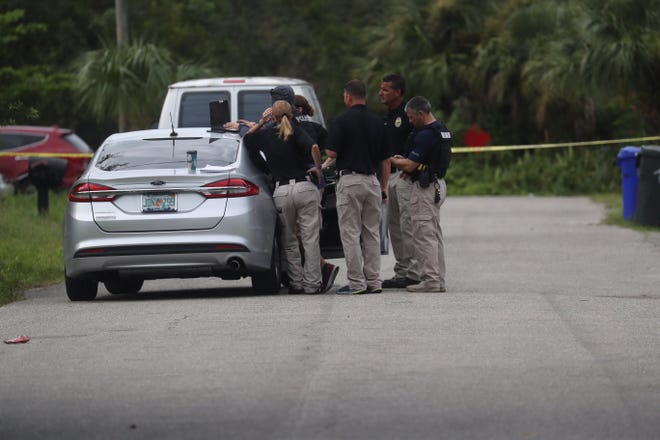 Members of the Fort Myers Police Department work a scene near the intersection of Lincoln Blvd and Cuba Street on Tuesday, Sept. 11, 2018. One person is dead from a gunshot wound.