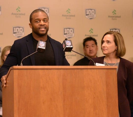 Randall Cobb introduces Kristin Jacobs of CASA Brown County Tuesday, Sept. 11, 2018, at Lambeau Field. Cobb selected CASA for a $50,000 community action grant.