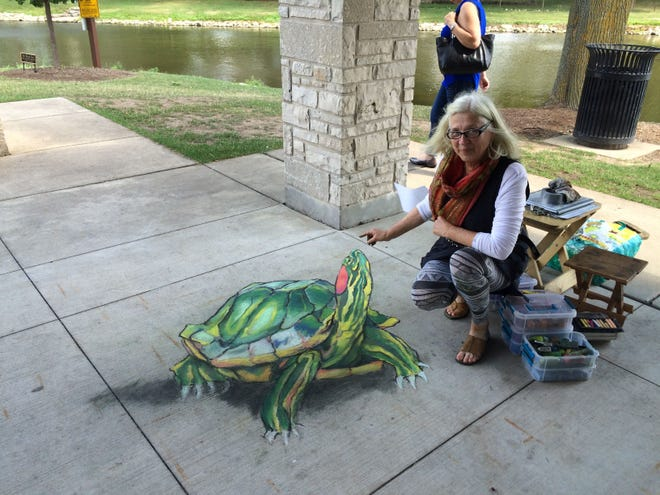 Professional chalk artist Kitty Dyble Thompson, shown with some of her art, will draw on the sidewalks of Sturgeon Bay on Sept. 15 as part of Chalk the Bay.