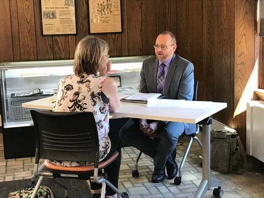 Hotel Northland comptroller Kevin Schneider interviews a job applicant Tuesday. The Northland is looking to hire 135 people for a variety of positions.